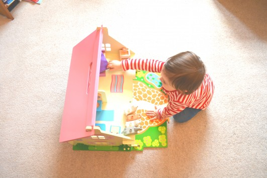 Ava with her doll's house