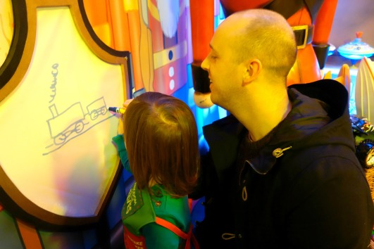 Daddy and A drawing a train at Kingdom of the Elves