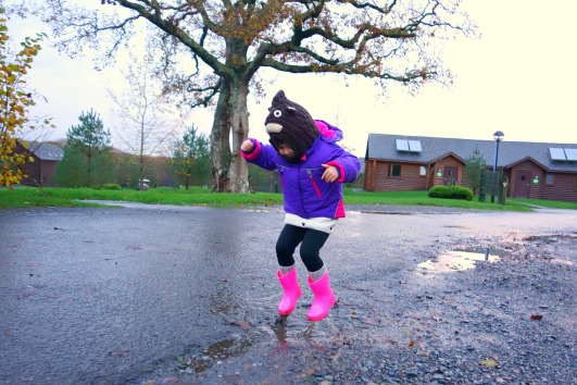 Jumping in muddy puddles at Bluestone Wales