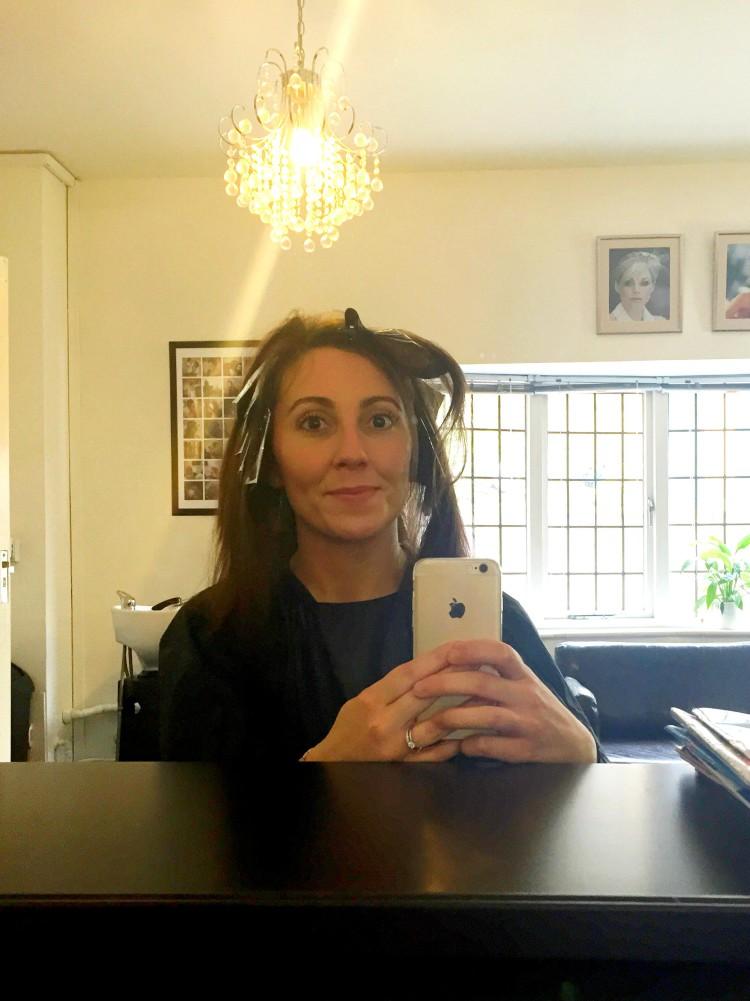 Getting my hair did.