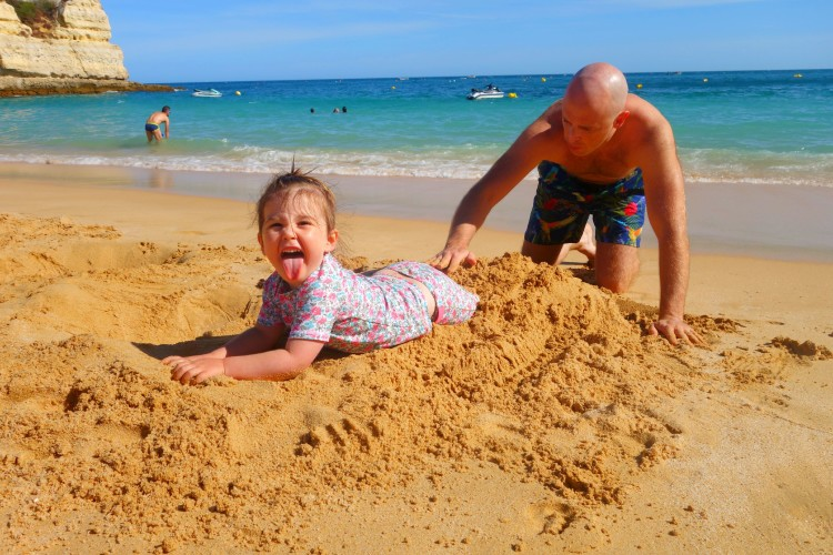 Playing on the beach with Daddy