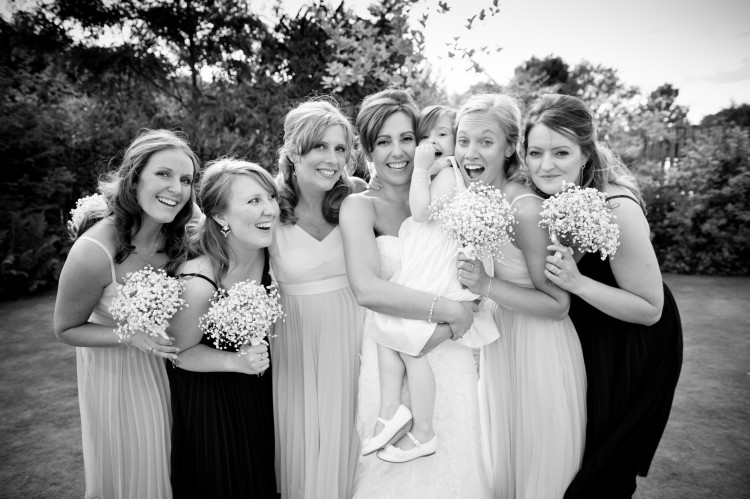 With bridesmaids and flower girl